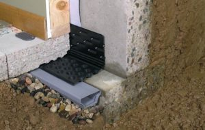 Basement waterproofing products inside a home in Worcester